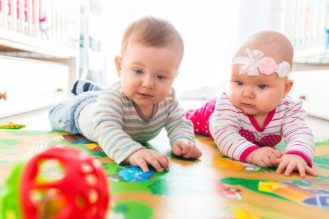 52545411-cute-baby-boy-playing-with-counter-toy-Stock-Photo
